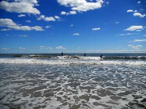Surfers ride the waves off Brigantine Island